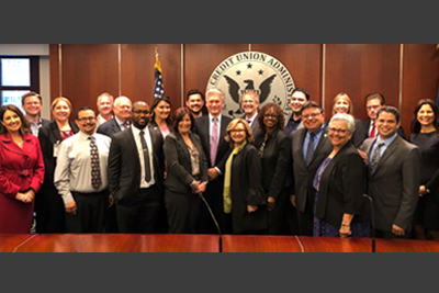 """National Credit Union Administration (NCUA) Board Chairman J. """"Mark"""" McWatters with credit union leaders from California and Nevada in the NCUA's board room."""