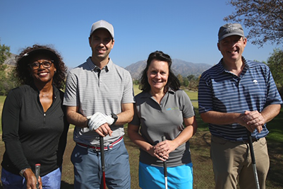 Golfers at REACH golf
