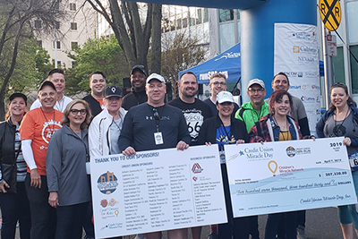 CU SacTown Run committee members, credit union leaders, and runners on race day.