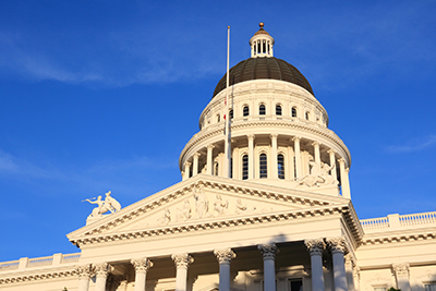 Image of California state capitol dome and flag