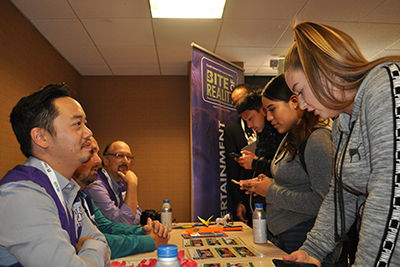 """Kids from Monterey High School making tough financial decisions during the """"Bite of Reality"""" financial simulation event at REACH."""