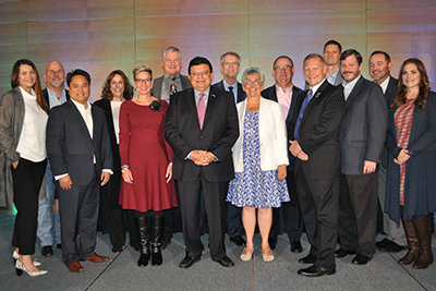 California and Nevada Credit Union Leagues President and CEO Diana Dykstra (center) with board members of the California League (left) and Nevada League (right).