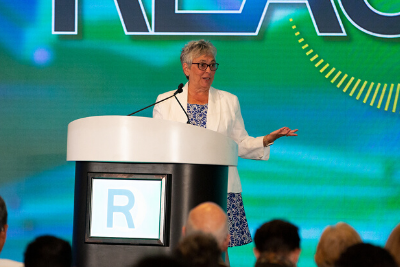 Diana Dykstra, President and CEO of the California and Nevada Credit Union Leagues, engages attendees of REACH during the opening general sesson.