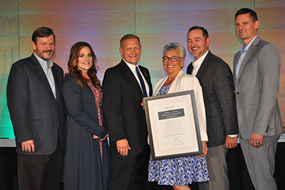 Nevada Credit Union League board members with Diana Dykstra (center) as she honors the league with a special proclamation for its 50th anniversary.